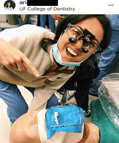 Dental student practicing and smiling with Medical Trainer