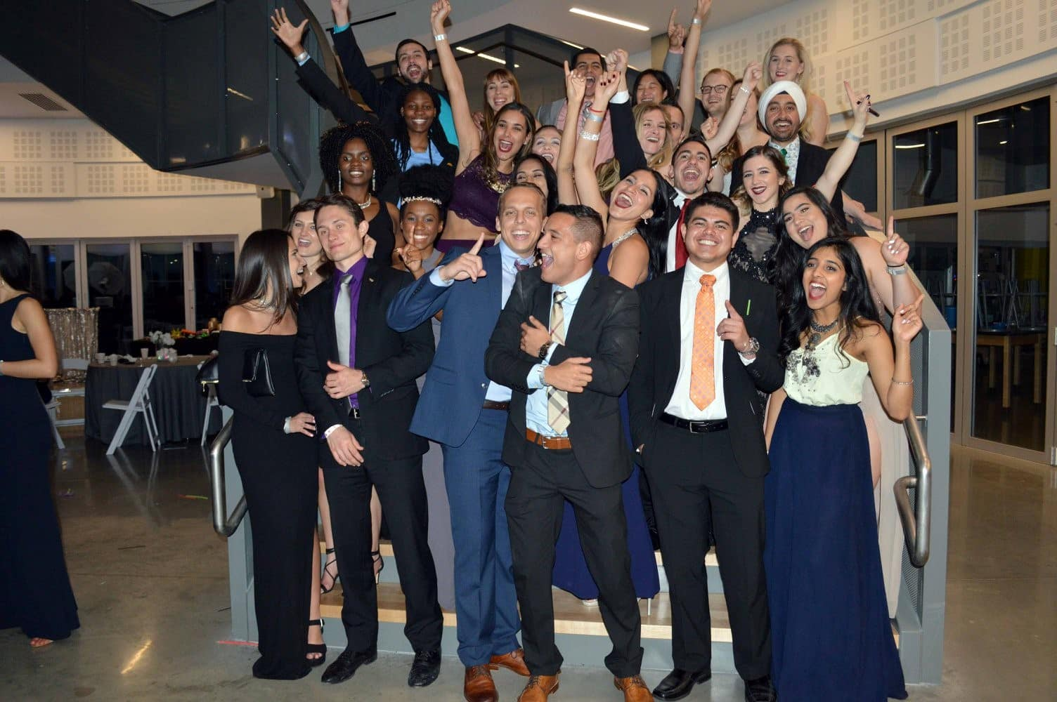 River Oak Dental Students celebrating with hands in the air and smiles all around.