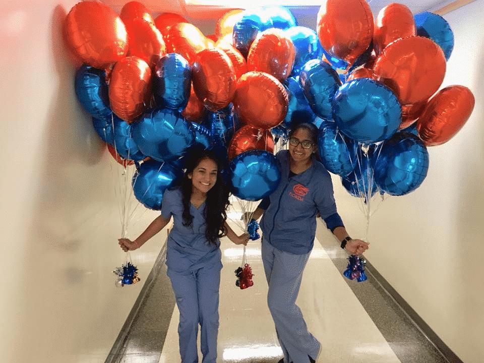 River Oak Dental team celebrating with balloons