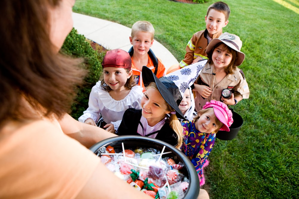 Future patients of River Oak Dental: children receiving halloween candy