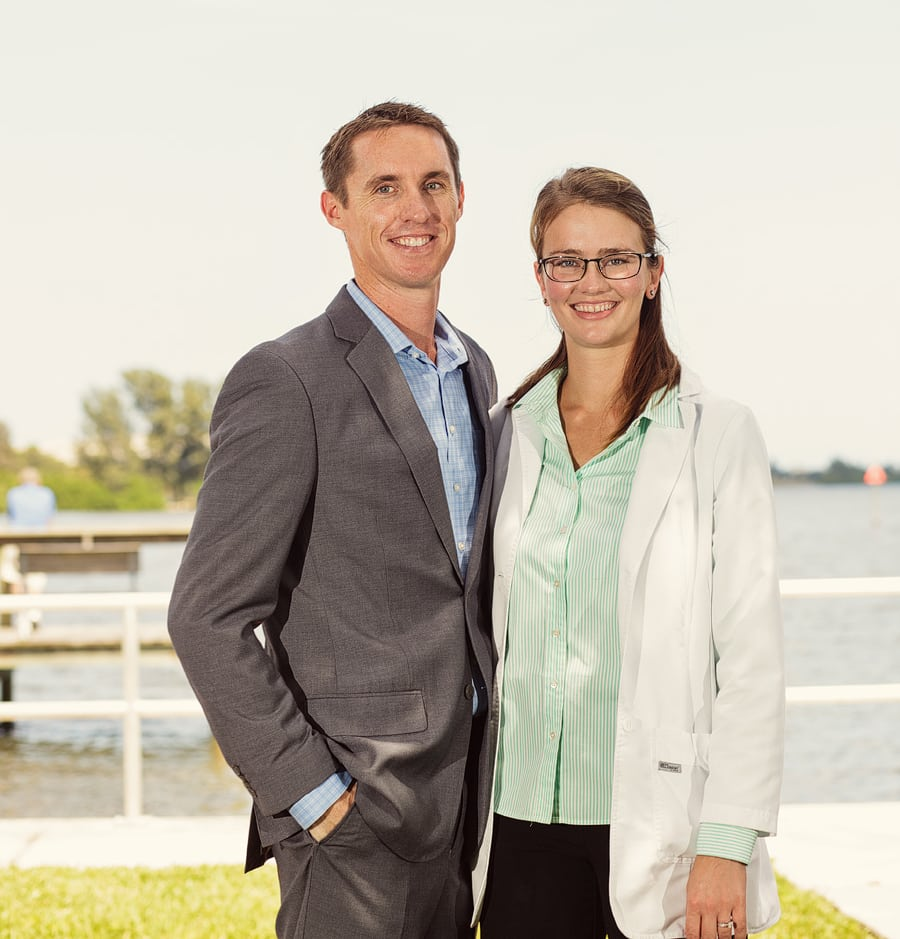 Dr. Liliana Marshall, head of River Oak Dentistry, poses with husband for photo in Palm Bay FL