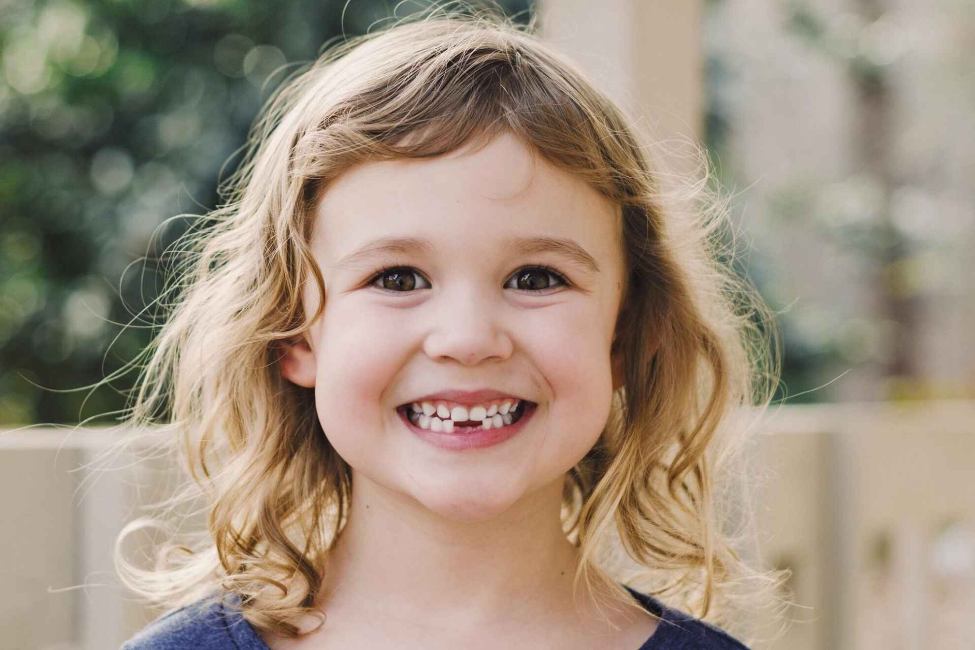 Little girl missing two lower front teeth